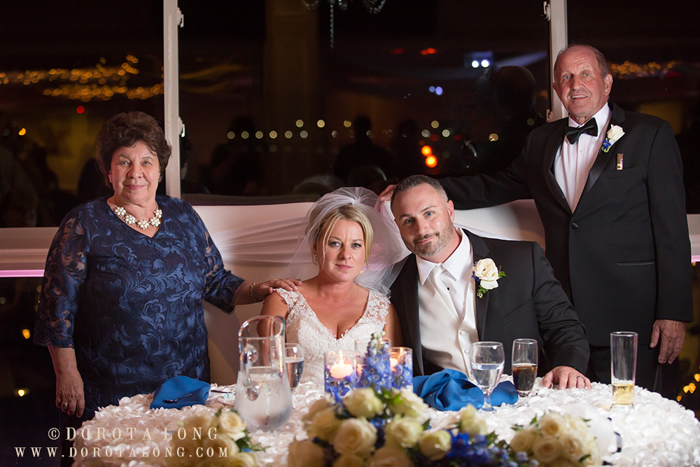 bride and groom with brides parents at anthony's ocean view wedding venue in new haven in ct