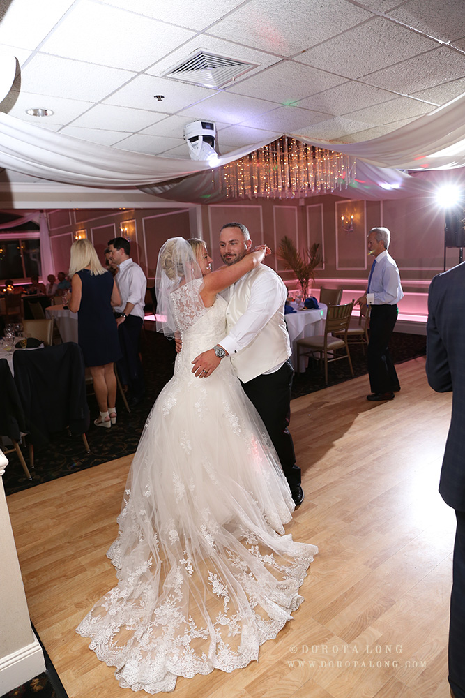 bride and groom dancing during their first dance at the indoor reception in new haven, ct