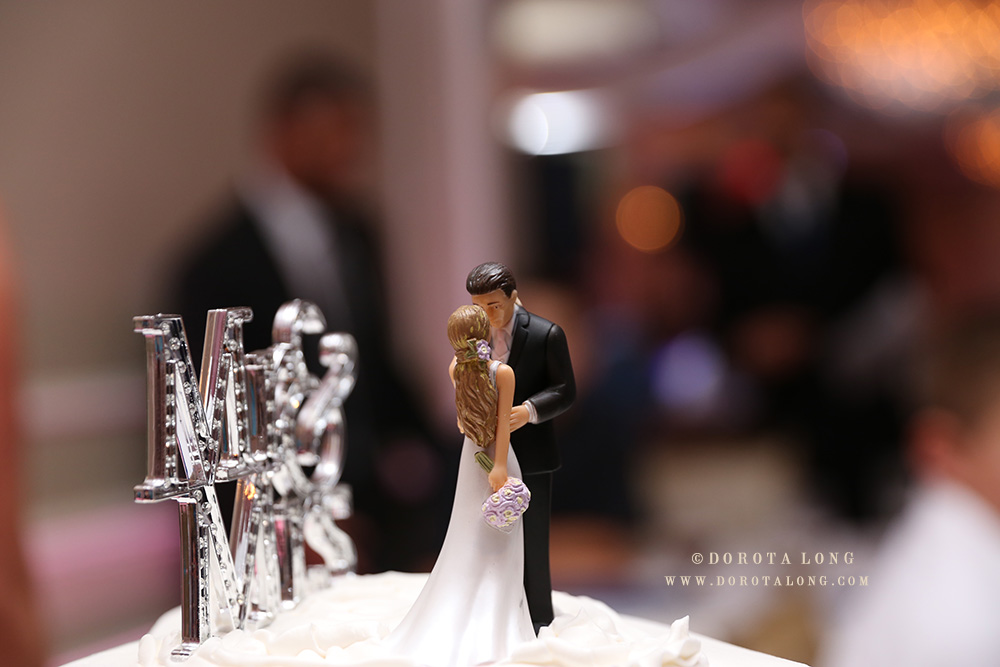 top of the wedding cake, bride and groom kissing. A nice wedding detail during reception in New Haven CT.