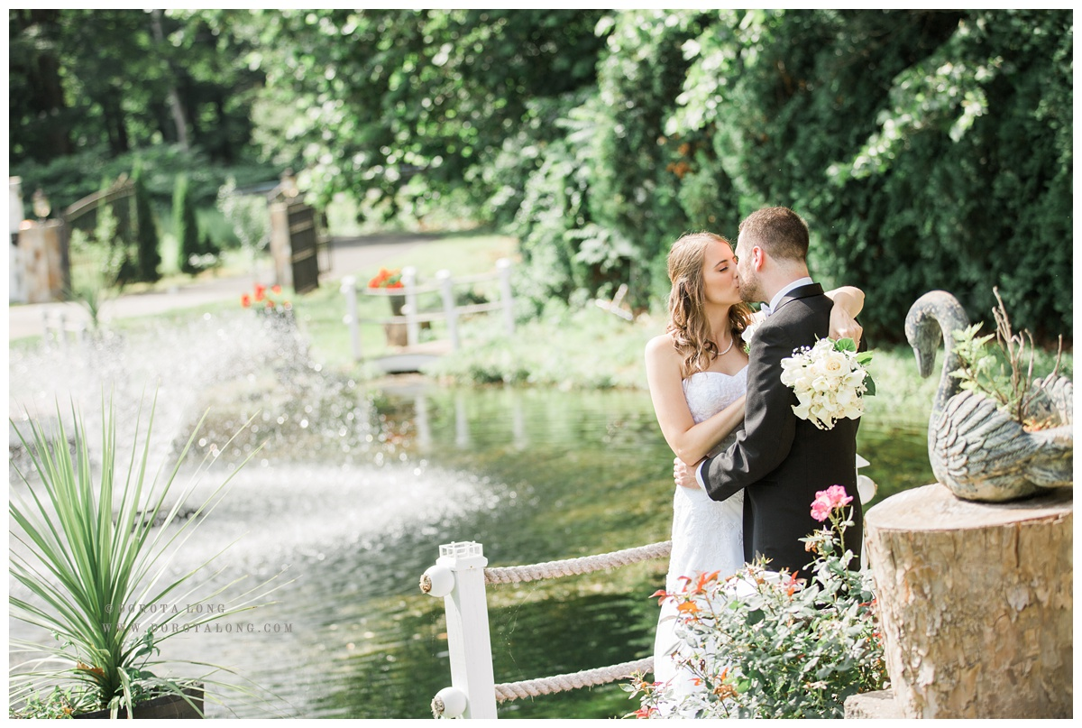 Villa Bianca outdoor, couple kissing by the pond wedding photographer in new haven ct